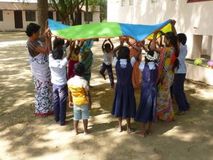 The children at the Sunshine Special School learn to socialise through playing games together.